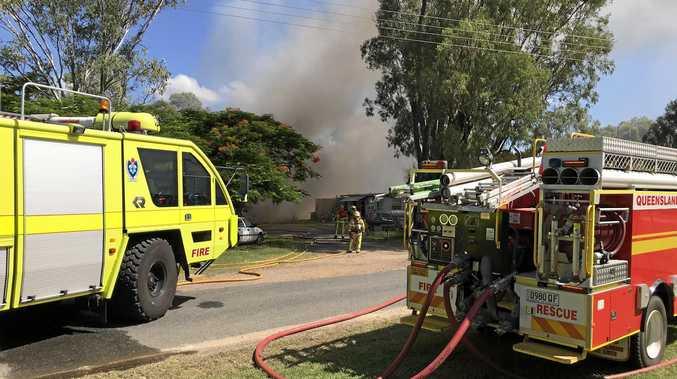 BILLOWING SMOKE: Sixteen crews attended a fire near Yeppoon where a blaze has ripped through properties.