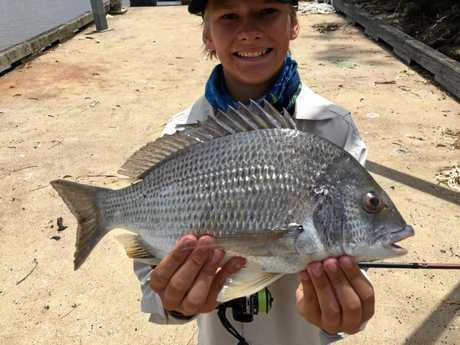 Robbie Jones with the 42cm bream he caught in the Burnett River recently.