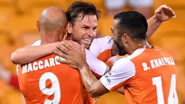 Brisbane celebrate after Holman's winner. (Bradley Kanaris/Getty Images)