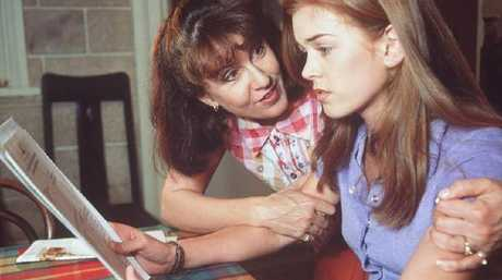 Isla Fisher's character Shannon is comforted by Pippa (Debra Lawrence) in Home and Away. Picture: Herald Sun