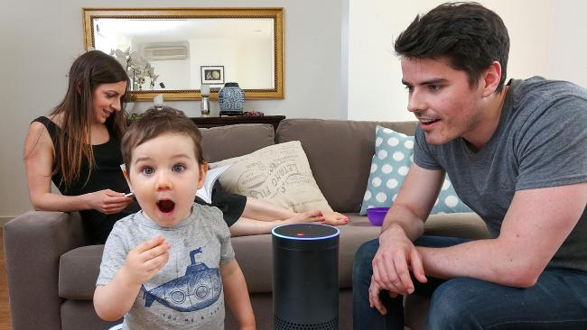 Amazon has revealed plans to launch its Echo range of smart speakers in Australia, as used by David and Emily Bain, and their 20-month-old son Liam. Picture: Ian Currie