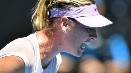 Russia's Maria Sharapova reacts after winning a point against Anastasija Sevastova.