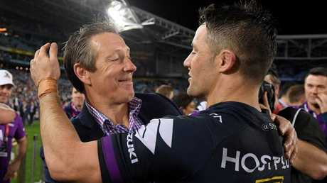 Melbourne Storm coach Craig Bellamy embraces Cooper Cronk.