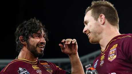 Michael Morgan (right) looks set to be one of the Queensland halves in the wake of Johnathan Thurston and Cooper Cronk stepping down from rep football. Photo: Mark Kolbe