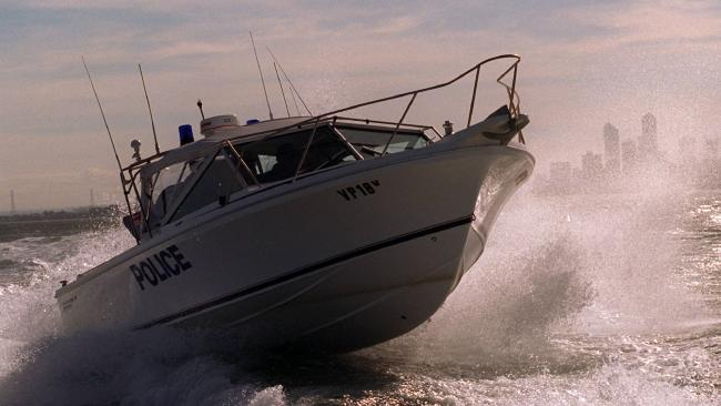 A boat carrying two people capsized near Frankston.