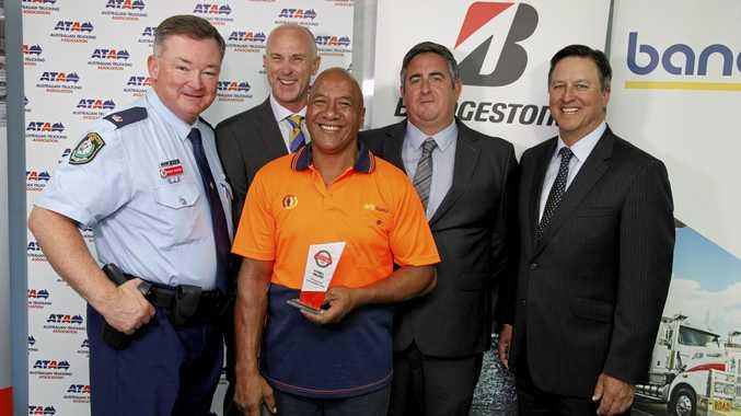 AWARDS: Chief Inspector Phil Brooks, Bridgestone's Geoff May, driver Darell Wilson, Bridgestone's Shane Cox and ATA CEO Ben Maguire.