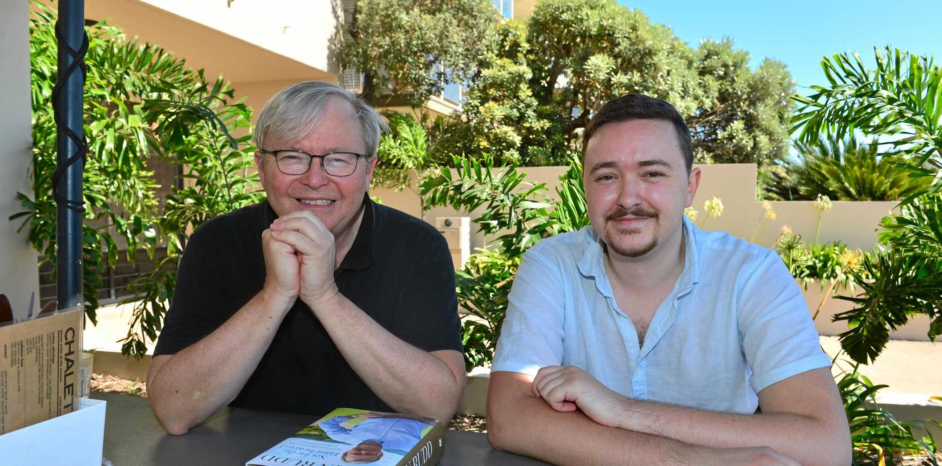 FORMER Prime Minister Kevin Rudd with his son Marcus and dog Abby at The Chalet & Co Cafe in Sunshine Beach, is back in Australia for a holiday at the family's northern beaches home just kilometres from where he grew up in Eumundi.