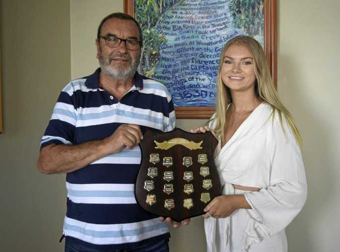 Zari Cansdell receives the Frank Glasson Memorial Scholarship plaque by Don Philbrook from the Grafton Midday Rotary Club.