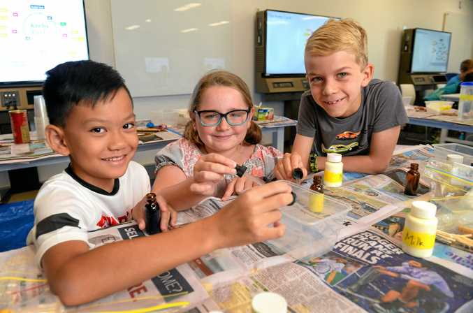 Connor Khammanipong, Pippa Ellis and Isaac Saban at the USQ gifted children workshop on Friday.