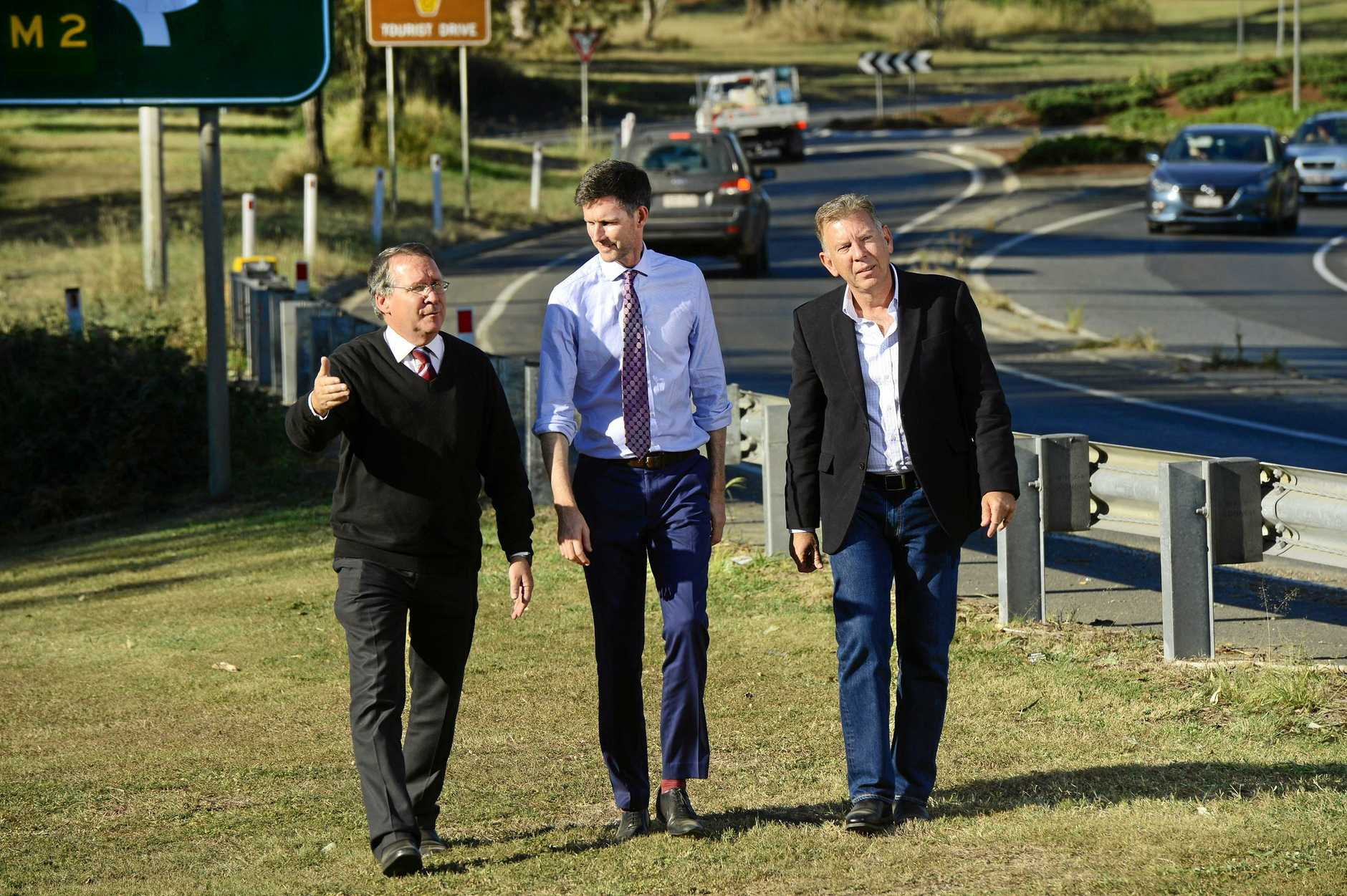 PROMISES: Member for Ipswich West Jim Madden and Transport Minister Mark Bailey with Deputy Mayor and former Ipswich West MP Wayne Wendt.