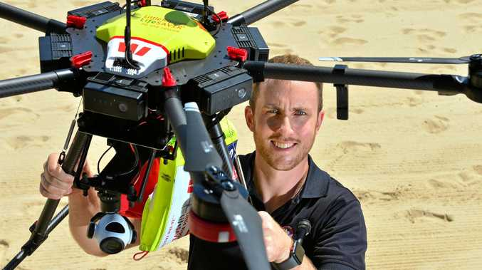 Regional manager of Surf Lifesaving Queensland, Aaron Purchase, with one of the Little Ripper UAV drones that have been facilitating beach patrols this summer.