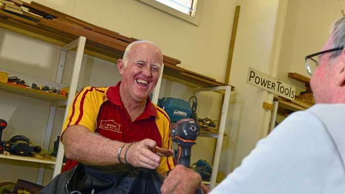 HELP FROM STRANGERS: Nambour Men's Shed Jim Simonsen gives Tony McDuie a set of battery-powered work tools after his were stolen last weekend.