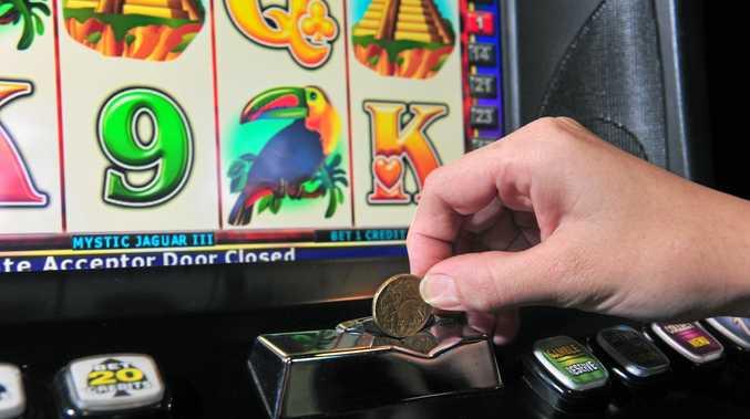 Gambling on the pokies.