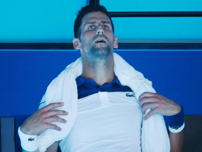 Novak Djokovic attempts to cool down between games.
