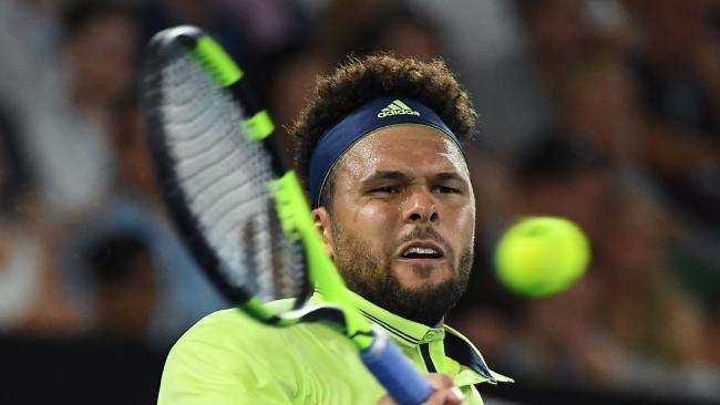 Tsonga fought hard but the Aussie proved too much at Melbourne Park
