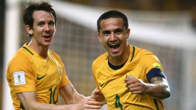 Robbie Kruse and Tim Cahill of Australia celebrate.