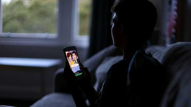 Australian parents are confused about setting healthy smartphone rules for their children, experts say, as two Apple shareholders demand the company takes action. Picture: Jack Tran