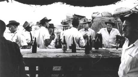 Men drinking at the bar at the Betoota races in Queensland 1961. Picture: David Moore