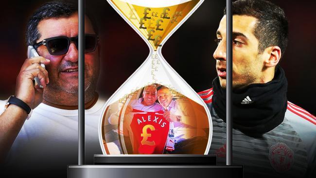 Mino Raiola and Henrikh Mkhitaryan control Alexis Sanchez's move.