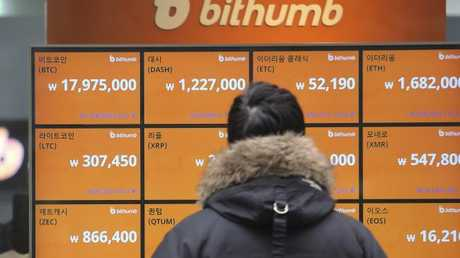 A man watches a screen showing the prices of bitcoin at a virtual currency exchange office in Seoul, South Korea, Tuesday, Jan. 16, 2018.