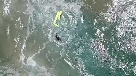 The device inflated when it hit the water allowing the surfers to hold on get into shore.