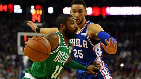 Kyrie Irving holds off Ben Simmons.