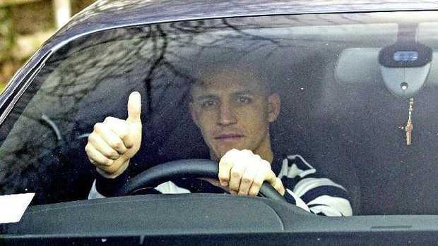 Alexis Sanchez arrives at Arsenal training.