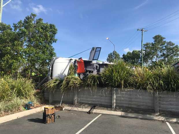 The car crashed through a fence.