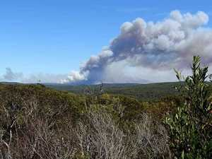Raging bushfire: 'Leave only if path is clear'