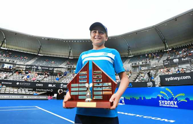 ON COURT: Caspian Tuckwell from Lindisfarne Anglican College  holds the Stolle/Hewitt Shield after NSW Primary Schools Under-11s beat South Australia at the Sydney International at the Sydney Olympic Tennis Centre.