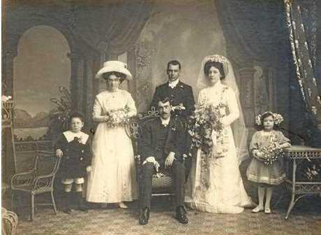 The wedding of Alma and Bert Clark, 1910. (From left) Mervyn (son of Heinrich [Harry]), Bertha Maynard; bride's brother Heinrich, bride Alma; small girl, daughter of Dagma. Bridegroom seated, Bert Clark.