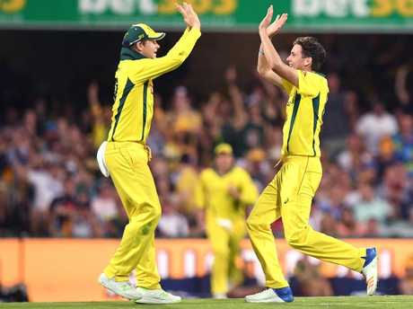 Australian captain Steve Smith (left) reacts with Jhye Richardson during the second One Day International cricket match between Australia and England at the Gabba.