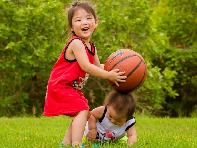 Doris Sun, pictured with her younger brother Oliver, before she was diagnosed with a fatal strain of brain cancer.