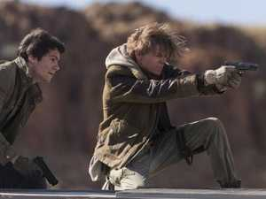 Dylan O'Brien, left, and Thomas Brodie-Sangster fire up in Maze Runner: The Death Cure
