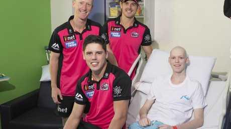 Cricket fanatic Nicolas met Sydney Sixers players Joran Silk, Daniel Hughes and Ben Dwarshius. Picture: Darren Leigh Roberts