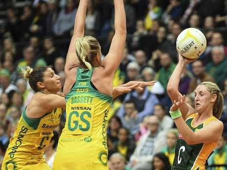 Erin Burger faces off  against Caitlin Bassett (centre) and Kim Ravaillion of Australia in a recent Test match.
