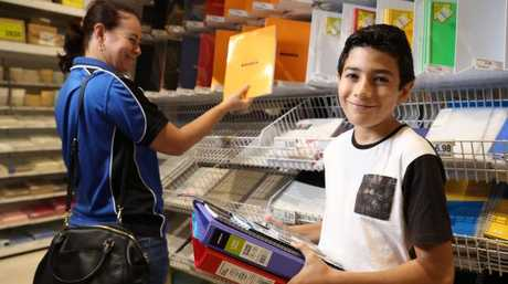St Stephen's Catholic College student Marco Cappella shopping for books and stationary at Officeworks with his mother Megan Cappella. Picture: Marc McCormack