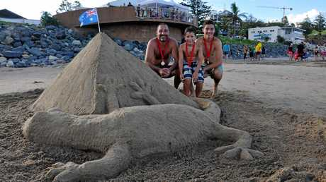George, Basil and Christian Psarakos with last years winning sand scultpture in the open division at the Australia Day activities in Yeppoon. Photo Trish Bowman / Capricorn Coast Mirror