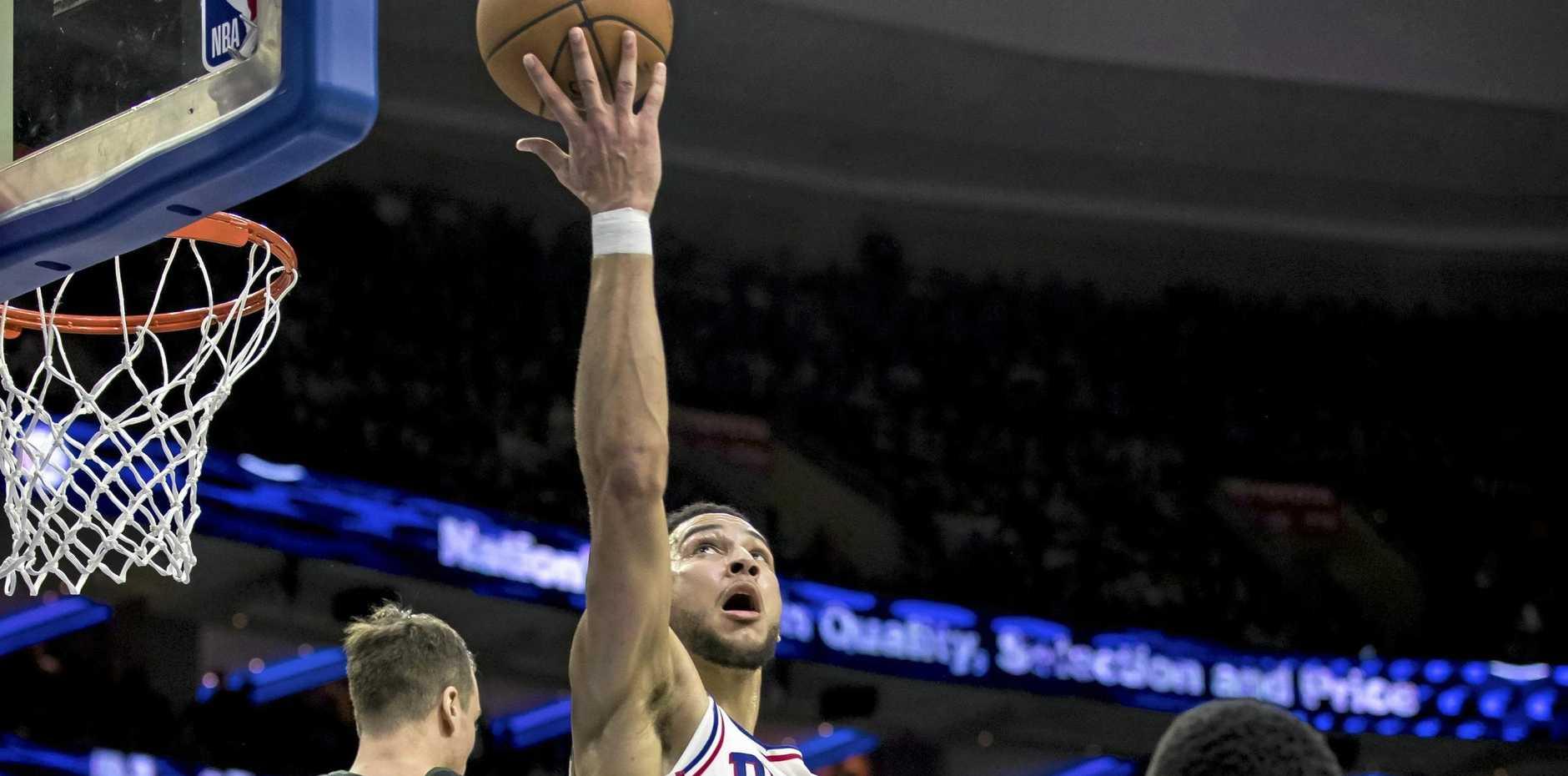 Philadelphia 76ers' Ben Simmons goes airborne against the Milwaukee Bucks