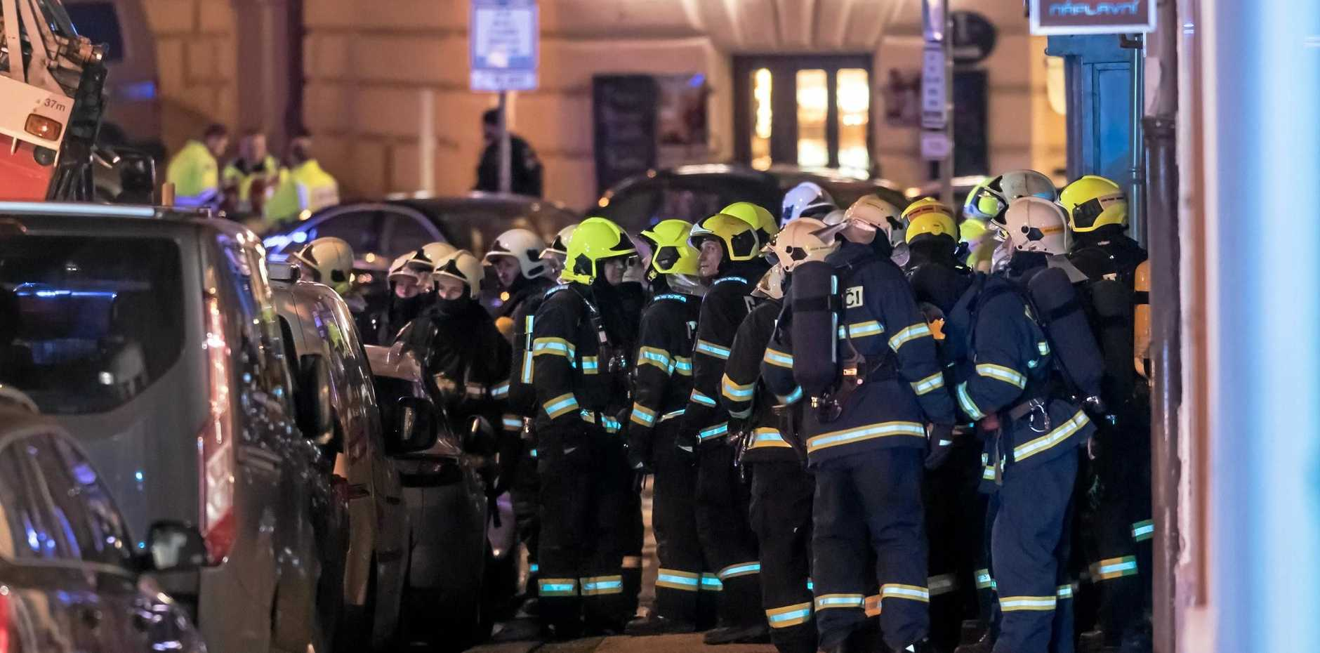 Firefighters prepare to enter the Eurostars David hotel in Prague, Czech Republic.