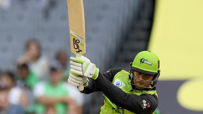 Usman Khawaja of the Thunder plays a shot during the Big Bash League (BBL) match between the Melbourne Stars and the Sydney Thunder at the MCG in Melbourne, Saturday, January 20, 2018. (AAP Image/Mal Fairclough) NO ARCHIVING, EDITORIAL USE ONLY