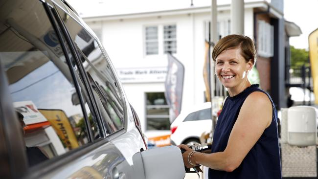 Jacqueline Davis pictured filling up for fuel at Tyres and More in Red Hill. Picture: AAP Image/Josh Woning