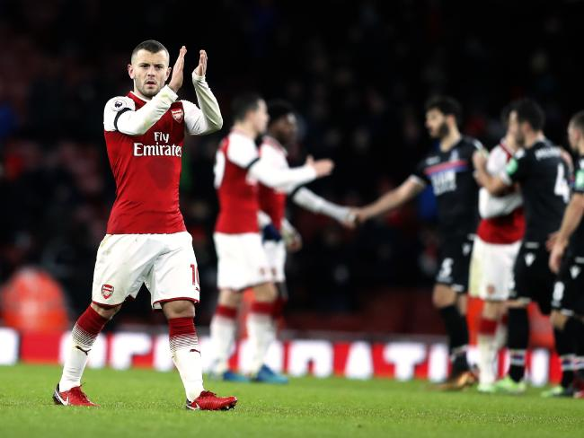 Arsenal's Jack Wilshere applauds to spectators