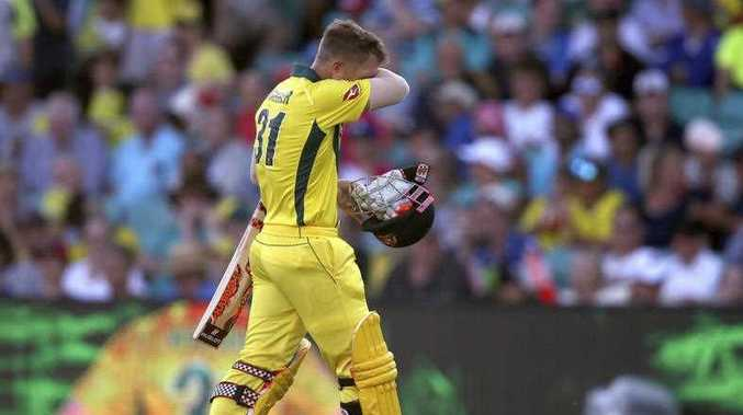 Australia's David Warner walks off after he was caught out by England during their one day international cricket match in Sydney, Sunday, Jan. 21, 2018.