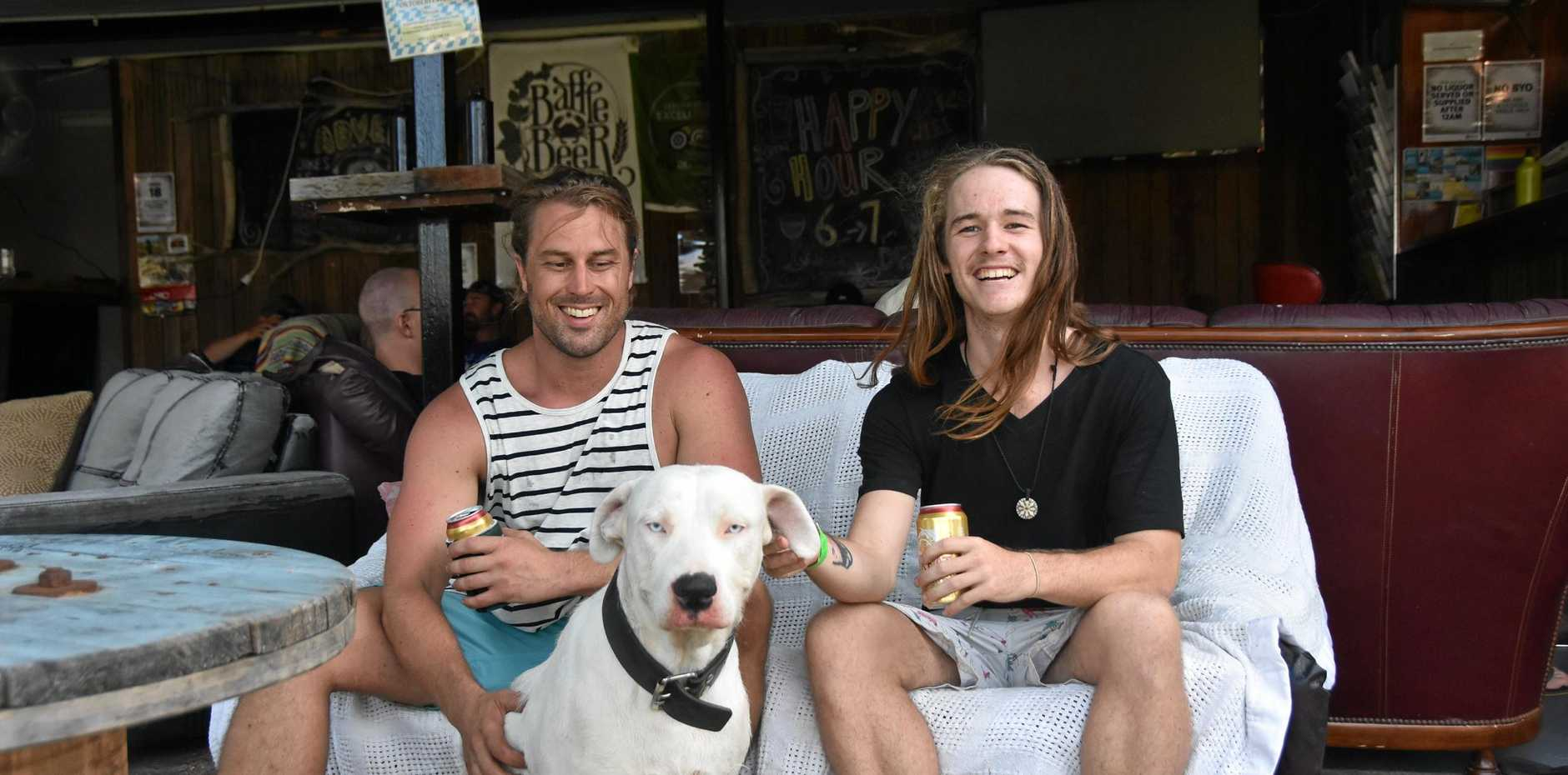 FRIENDLY VIBES: Gladstone Backpackers owner Luke McClelland and event manager Callan Reah and Luke's dog Charlie at Charlie's Bar. Visit the Gladstone Backpackers Facebook page for information about upcoming events.