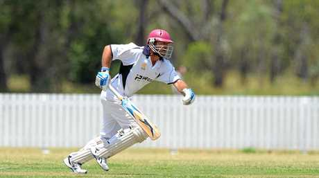 Rockhampton Brothers batsman Ken Litschner takes a single in the game against Frenchville.