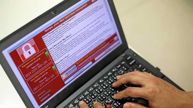A programer shows a sample of a ransomware cyberattack on a laptop.
