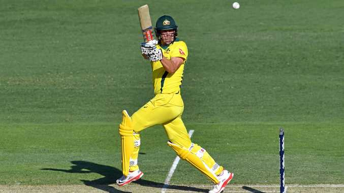 Cameron White of Australia dons the canary yellow one-day outfit, with ordinary collar.