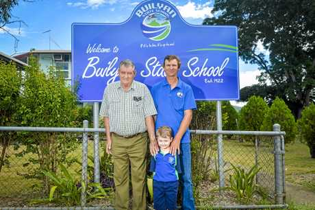 Prep student Joel Otto (front), pictured with grandfather Gordon Otto and father Craig Otto, is the third generation of his family to attend the Builyan State School in Boyne Valley.