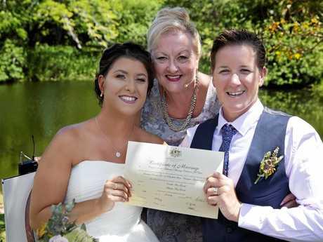 Mikayla and Emillie Glossop with celebrant Christine Smith.
